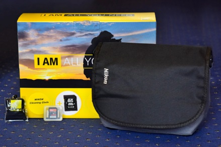 Nikon DSLR gadget bag, a 16gb class 10 SD card and a Nikon lens cleaning cloth