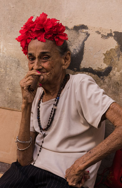 A Cuban lady smokes a cigar on the streets of Old Havana